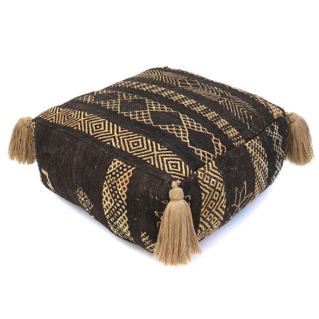 Vintage Moroccan pouf made from a Tuareg vintage rug handwoven in beige and black wool. New custom poly insert with zipper...