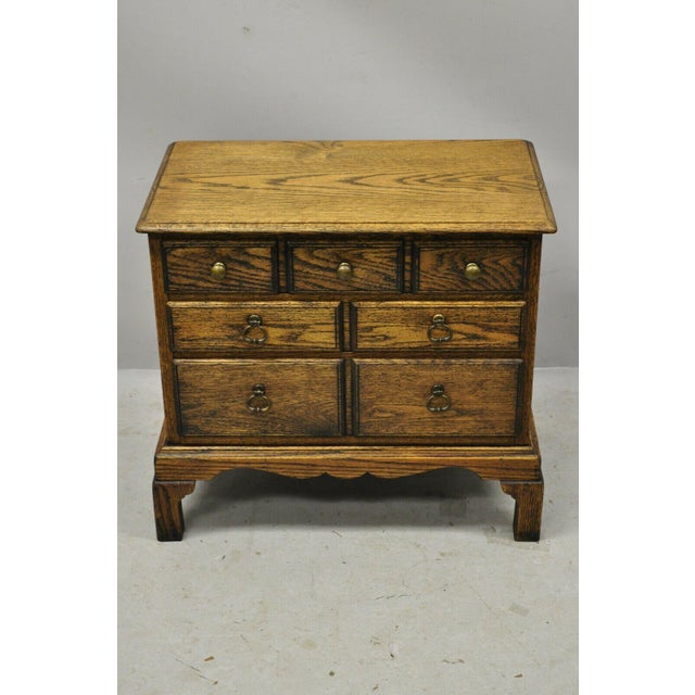 Vintage English Colonial Style Small Miniature Oak Wood Campaign Chest Side Table. Item features solid wood construction,...