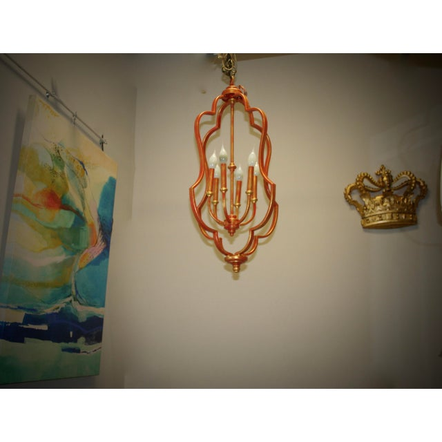 This fixture has been given a new look with the bright Tomato Tango finish with gold accents. Let the room dance with they...
