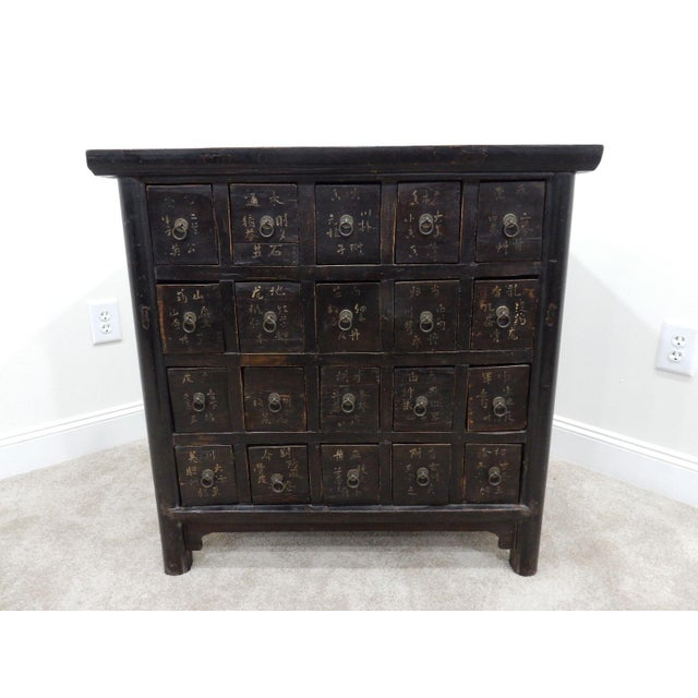 Antique Chinese apothecary/spice hardwood elmwood cabinet. Each drawer is fitted with removable interior dividers. This...