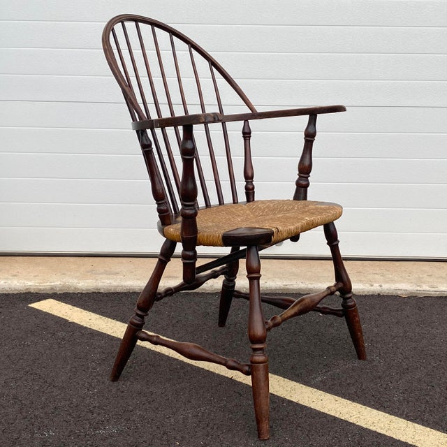 A very comfortable antique sack back Windsor chair with rush set and original metal tag from Hathaway Furniture W.A....