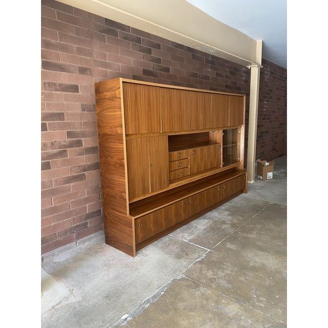 Fantastic addition to any large home/office/hospitality space. This breathtaking and unique made in West Germany cabinet...