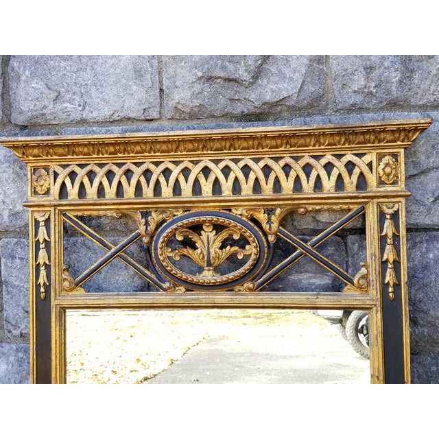 This is a very large mid 20th century Empire Style mirror made in Italy.It is hand carved and gilt wood with black painted...