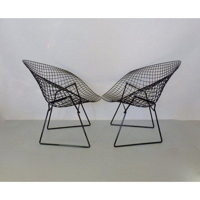 Recently restored in gloss black powder coat. Pair of Harry Bertoia for Knoll welded steel diamond chairs. C. 1960s.