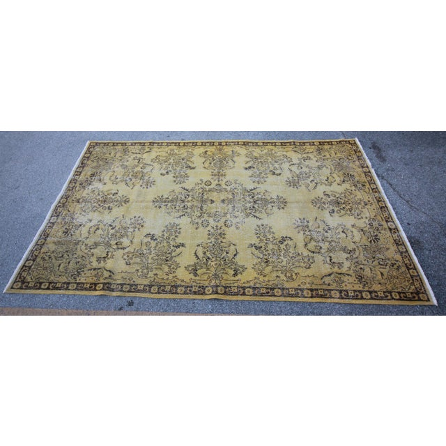Distressed Vintage Turkish Overdye Rug. This one is a classical piece from1960-1970's and wool on cotton. The rug has been...