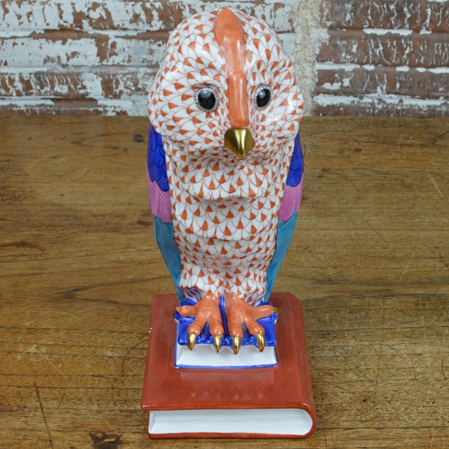 Fine Hungarian porcelain figurine by Herend featuring an owl perched on a stack of books with a hand painted rust fishnet,...