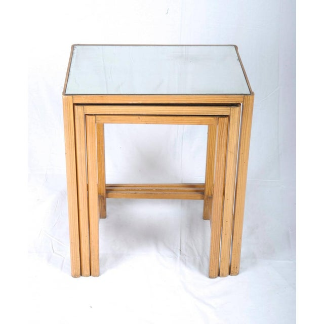 This set of vintage nesting tables was made for Thonet in Austria in 1930. They have wooden frames with mirrored table...