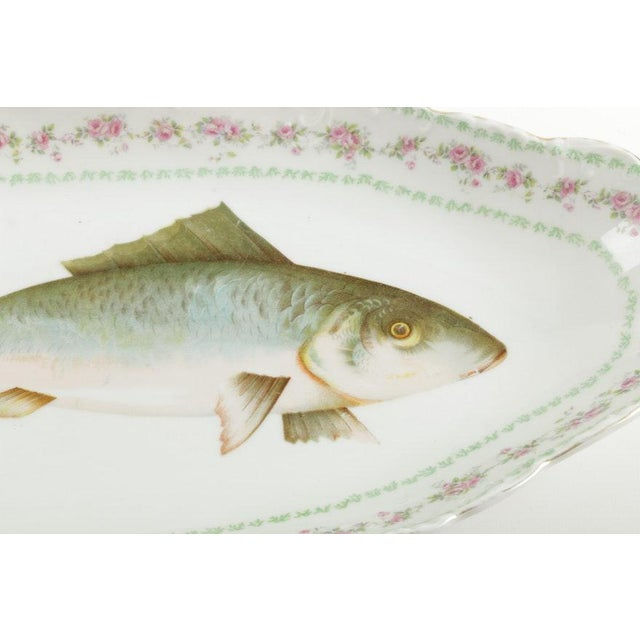 A porcelain platter by LS (Lewis Straus) & S Carlsbad. It has a fish design to the center with floral and foliage trim....
