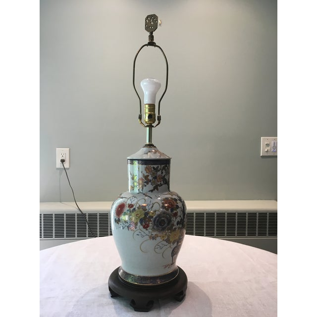Lovely larger Asian vase table lamp on a wood base. Looks to be hand painted with a metallic gold outline. Crackle glaze...