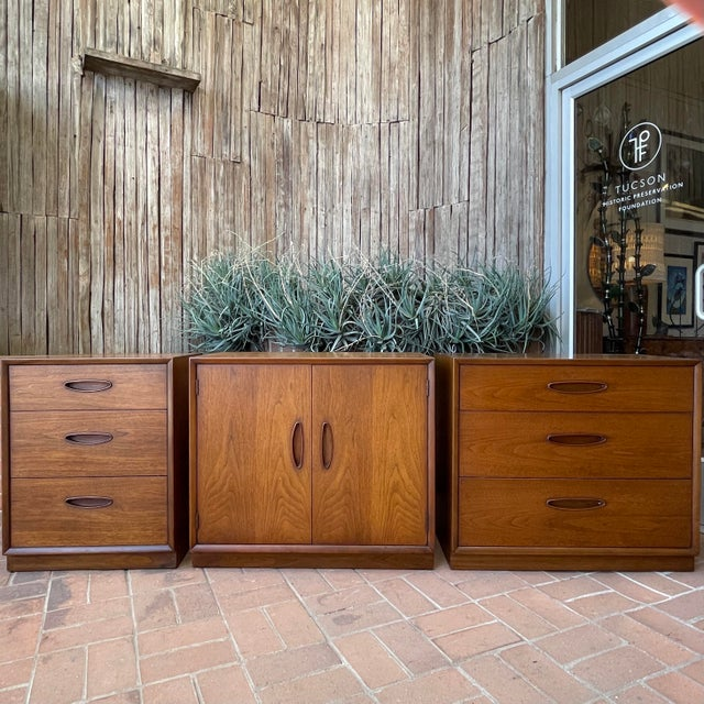 Henredon 'Circa 60' set of walnut cabinet with 3 varied designs. Oo, la la - can be used abutted together as a credenza-...