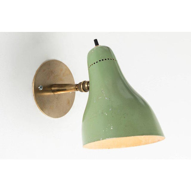 Pair of 1960s Stilux Articulating Sconces in the manner of Gino Sarfatti. Executed in brass and green painted aluminum....