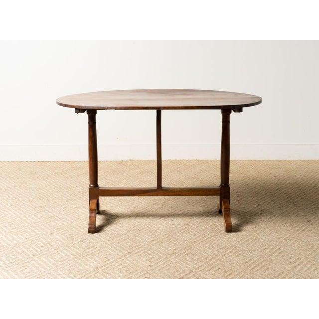 Mahogany oval tilt-top table from France, circa 1900.