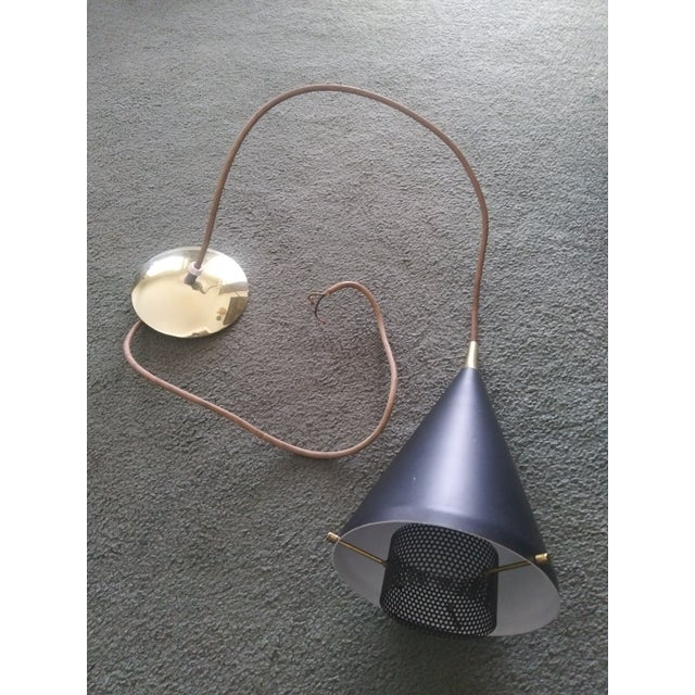 Up for grabs is this Amazing Pendant light designed by Gerald Thurston for Lightolier. It makes a great light for any...