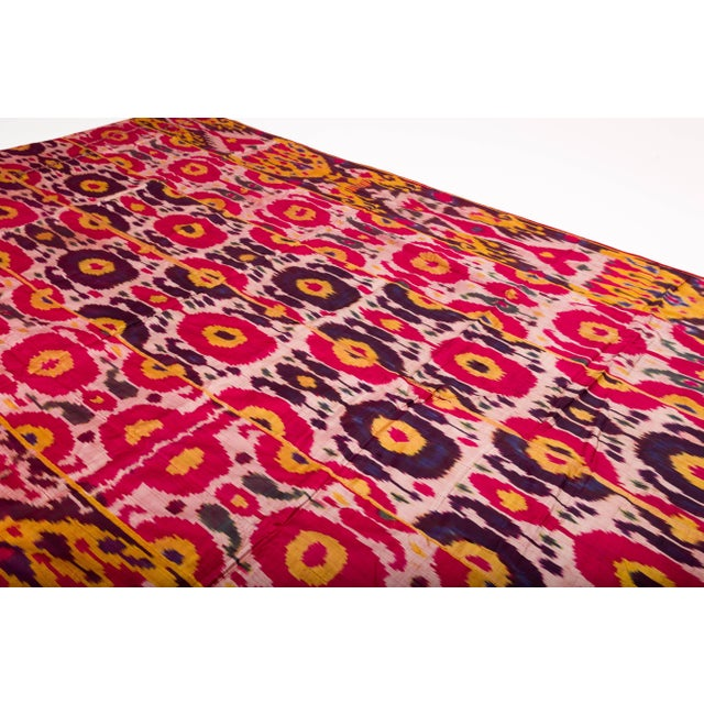 Gorgeous handwoven silk Ikat weaving in rich magenta, gold and purple color, circa late 19th-early 20th century,...