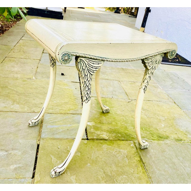 Stylish accent table with winged detail, paw feet and a wonderful faux painted top that looks like a tooled leather...