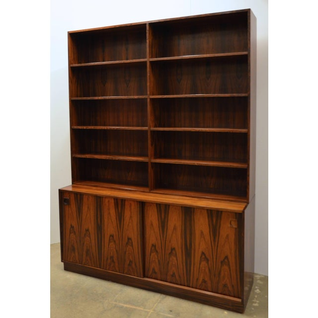 Danish Mid-Century Modern rosewood bookcase, the unit in two sections having adjustable shelves to the upper case, the...