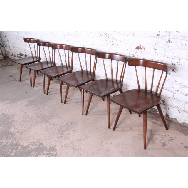 A gorgeous set of six mid-century modern spindle back dining chairs Designed by Paul McCobb for his Planner Group line for...