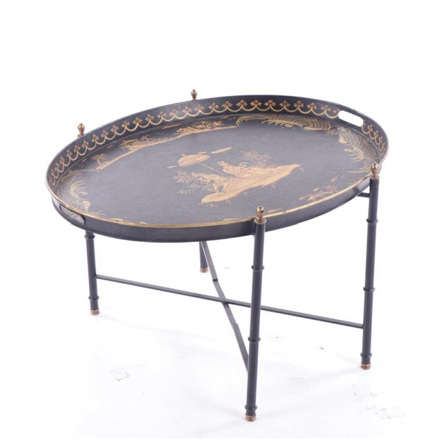 Vintage chinoiserie style painted coffee table. This piece features a removable tray top, hand painted gold accents and...