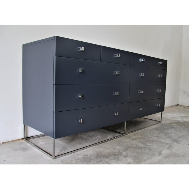 Elegant Mid-Century Modern dresser by Roger Rougier. The piece is accented with handsome chrome pulls and a sturdy boxed...