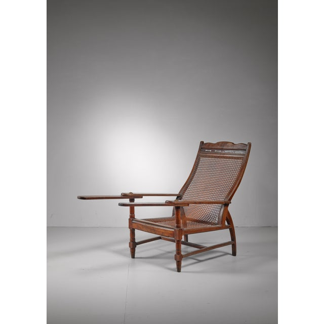 Jugendstil Planter's chair in teak, cane and brass, Italy, circa 1900 For Sale - Image 3 of 8