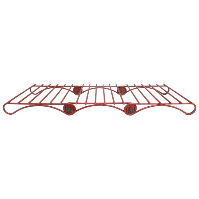 An incredible and highly-unusual, double-articulated, steel chaise longue. An inspired and well-executed construction,...