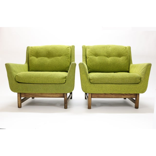 A rare pair of Danish MId-Century Selig Vista lounge chairs attributed to Dan Johnson. Original upholstery on walnut legs.
