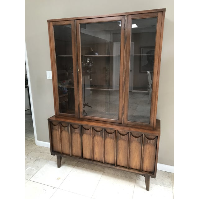 Mid century modern one piece walnut and rosewood china hutch/credenza. This iconic 1960s design by Kent Coffey in the...