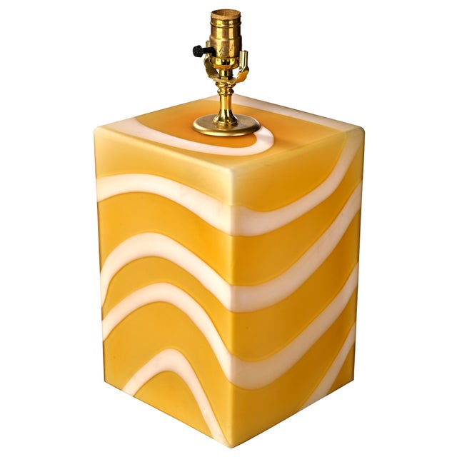 Beautiful golden rod and white stripe Murano glass table lamp. Made in the mid 20th century.