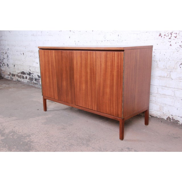 An exceptional mid-century modern sideboard or bar cabinet designed by Paul McCobb for his Irwin Collection line for...