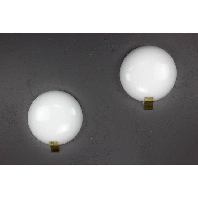 Pair of wall lights with opaline globes and bronze mounts. Made by Perzel, French 1970's
