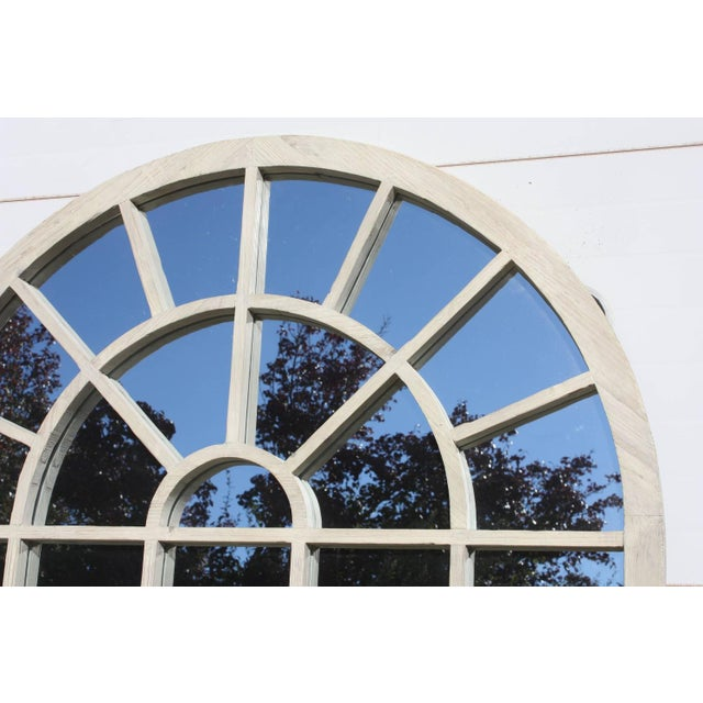 Contemporary white washed and repurposed arched wood, with cathedral style lines. Window frame over clear glass mirror...