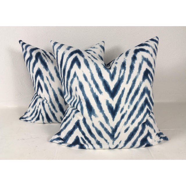 This is a pair of large vibrant white and blue flame stitch cotton print pillows back with a dark blue cotton reverse....