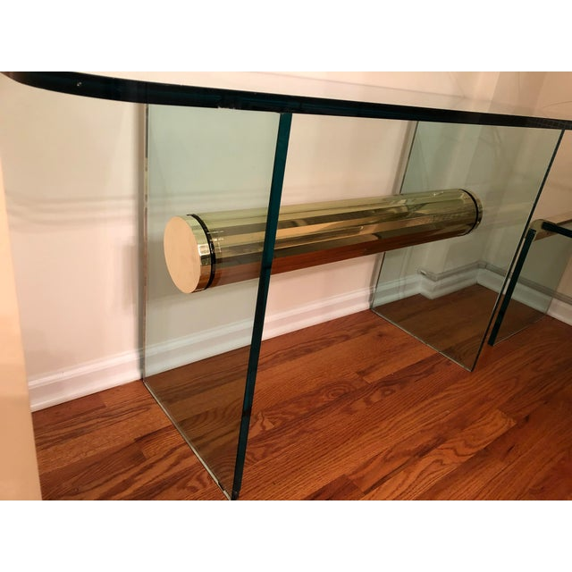 """Substantial mid-century modern and super heavy console table with 3/4"""" thick glass with a large cylinder brass connector...."""