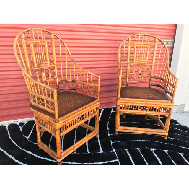 Matching pair of Brighton Pavilion tortoise shell finish bamboo and cane arm chairs. Chinese Chippendale Boho or...