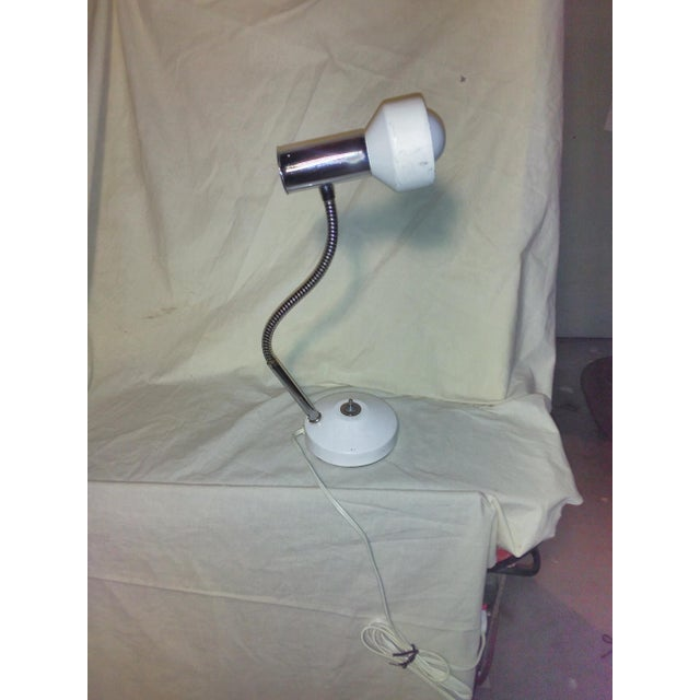 This vintage desk lamp will work well for a student or small office. It's an original piece that has some wear but...