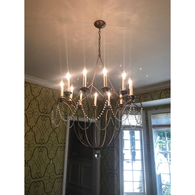 The Italian Chandelier simple, elegant outline is based on a voluminous 18th century Italian sconce. The suspension system...