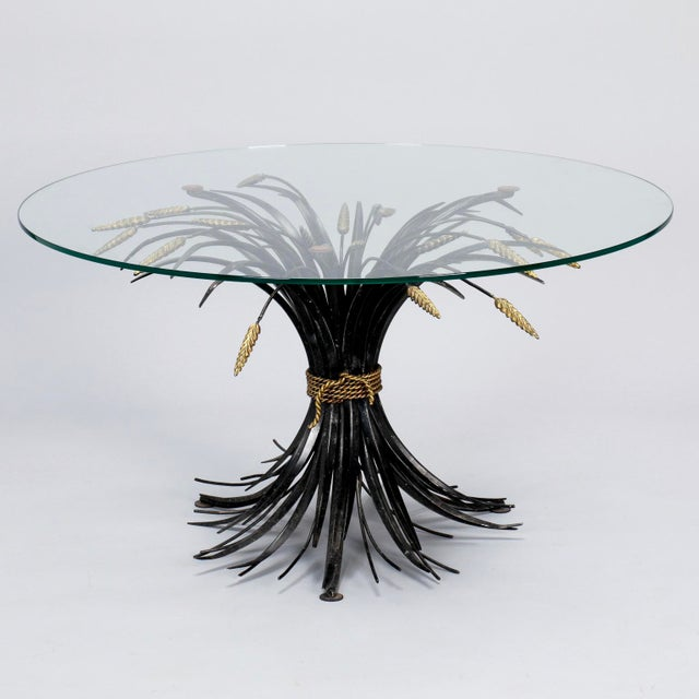 Found in Italy, this circa 1940s table has a metal base in the form of wheat sheaf gathered with braided rope. Unusual...
