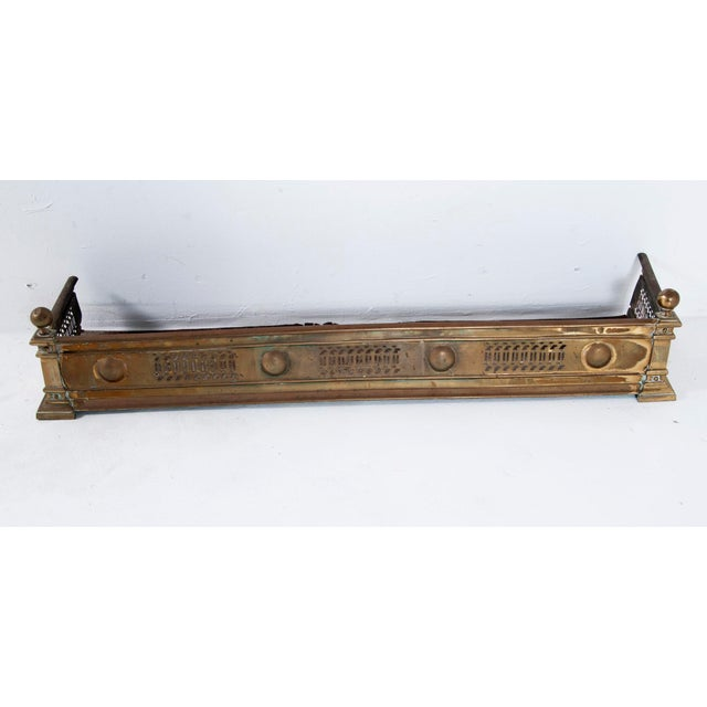 A very nice looking mid 19th Century English brass fire fender decorated in neoclassical motifs. We think this piece dates...
