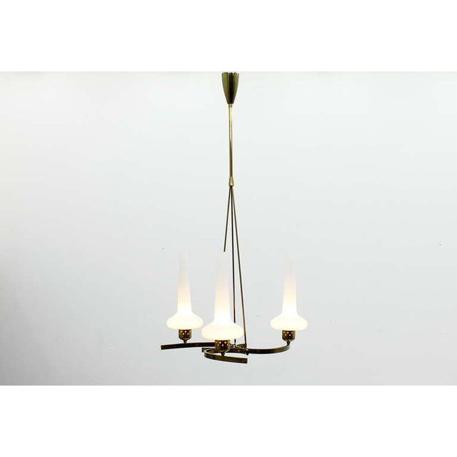 Nice Chandelier from the late 50s, Italy. Glass and Brass, very good Condition! Express shipping is worldwide possible....