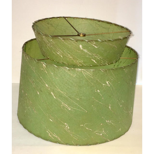 This as a really great mid century shade. Glows a lovely atomic green when lighted! There is one small burn mark on the...