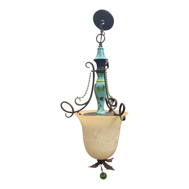 Hand-painted chandelier by Tracy Porter. Her designs of luminaires for Savoy House are timeless jewels that become the...