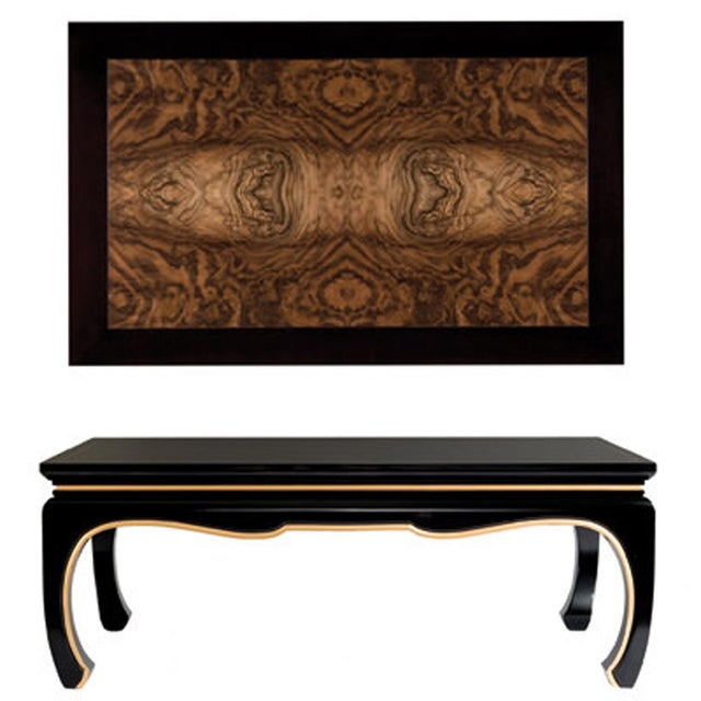 The Yumi Cocktail table features exotic Walnut Burl in a four-piece top that is book-matched and butt-matched to create a...