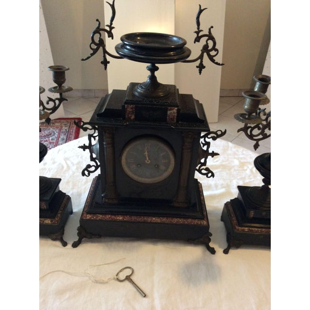 Amazing large french mantle clock in the imperial (Napoleon) style in black marble with rose marble highlights with...