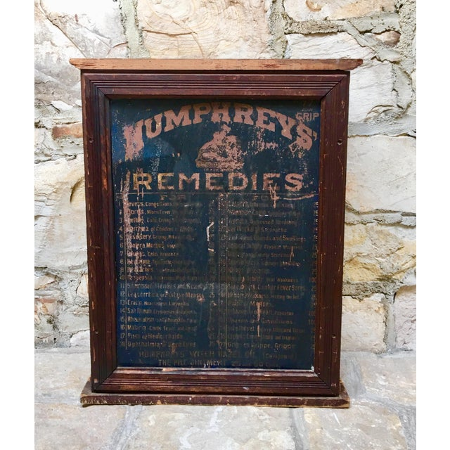 Vintage advertising apothecary cabinet with original Humphreys' Remedies tin front & 34 original drawers in the back. This...