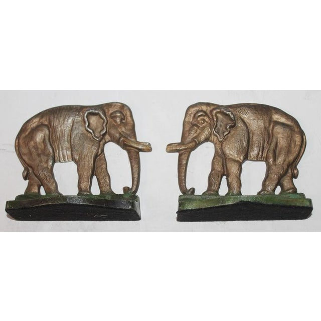 Pair of 1930s original painted cast iron elephant bookends. The condition is very good and are unsigned.