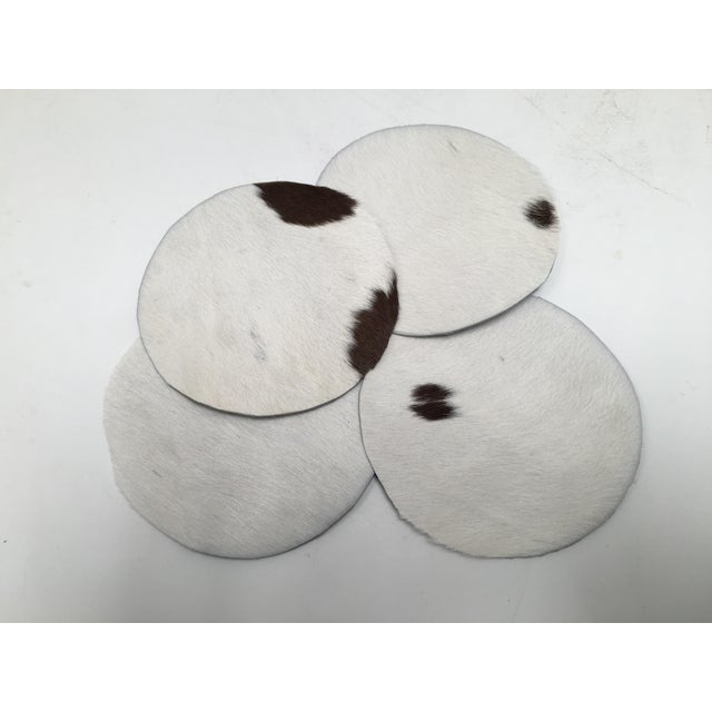 Set of 4 genuine cowhide coasters. They are a generous 4 inches in diameter to accommodate a mug, wine stem, or cocktail...