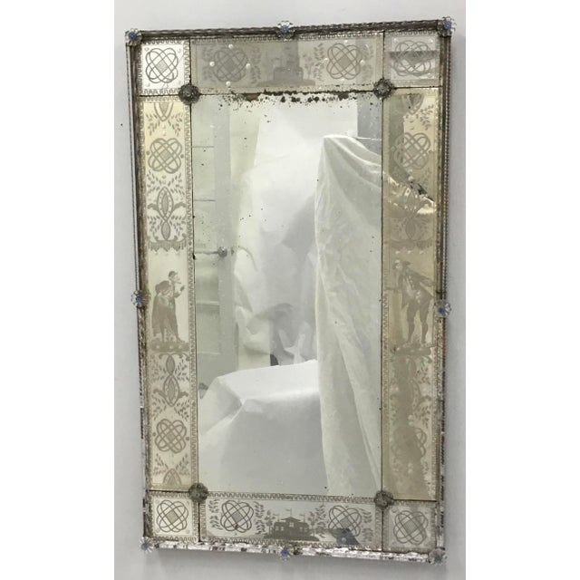 Beautiful antique Venetian mirror hand etched with scrolls , buildings and figured . Early 19th century with a lot of...