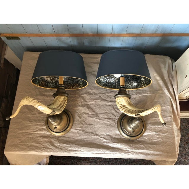 A pair of vintage horn sconces with brass detailing and original silver marbled gray paper shades. Very heavy, but oh...