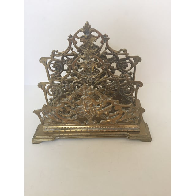 This traditional brass letter holder fits nicely with just about any décor. Its scroll design adds panache to a desk or...