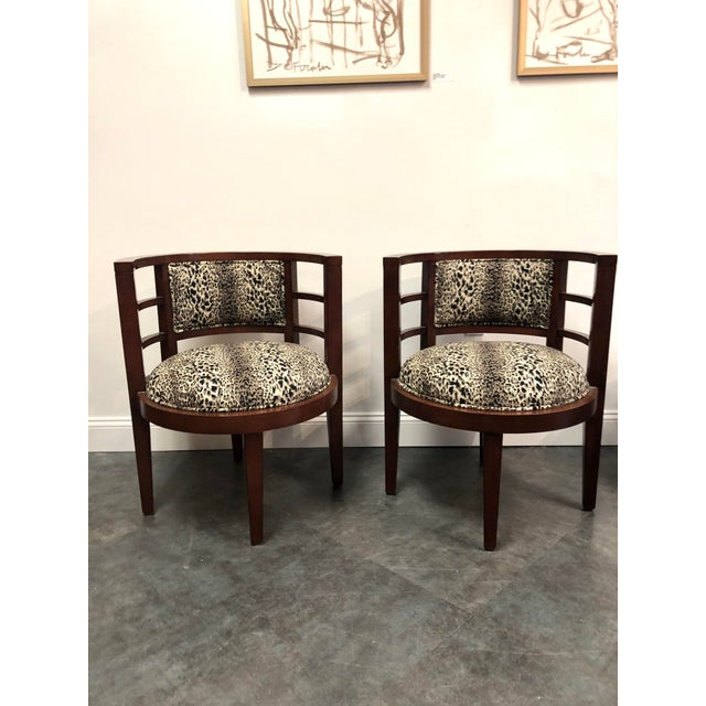 Pair of Hollywood regency wood framed barrel back chairs with newly upholstered cheetah / leopard print fabric. Excellent...
